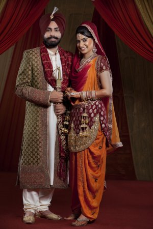 Sikh bride and groom on indian wedding ceremony