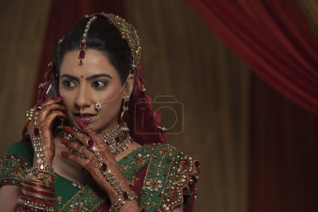 Indian bride talking on cell phone