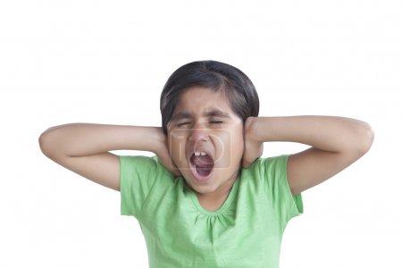 Little girl covering her ears