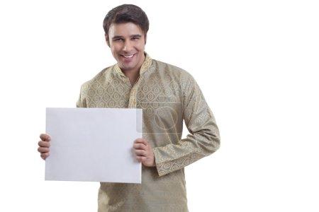 Bengali man holding a white placard