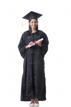 graduate student holding diploma