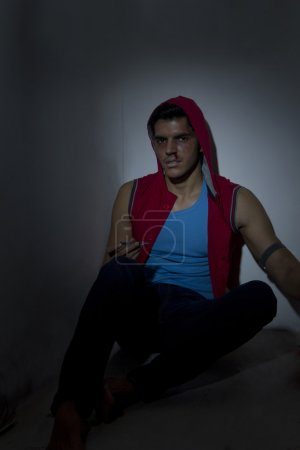 Male drug addict with syringe