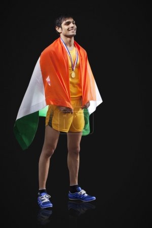 Male medalist with Indian flag