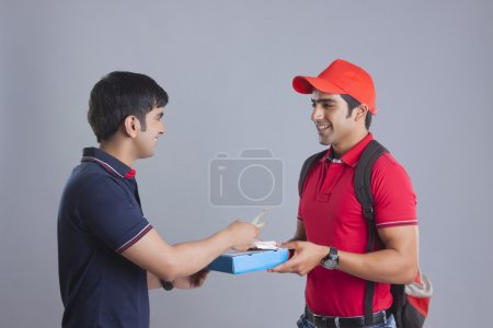 Delivery man delivering pizza