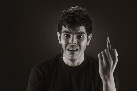 Portrait of male drug addict