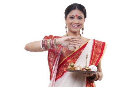 Bengali woman holding a puja thali