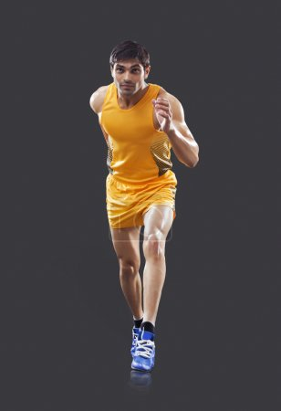 Young male runner running