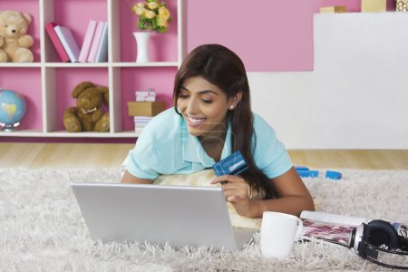 Beautiful woman shopping online at home
