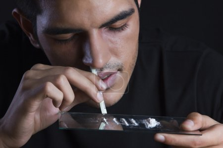 Male drugs addict with cocaine