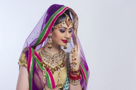 Shy Indian bride standing