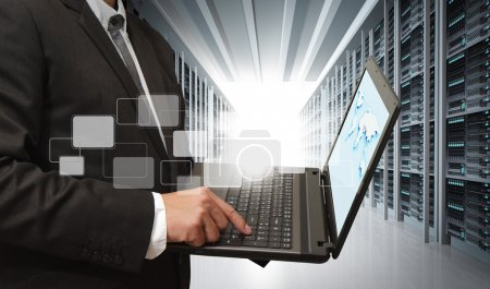 Photo for Business man use notebook in server room - Royalty Free Image