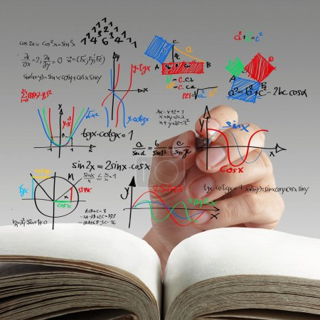 Photo for Male teacher writing various high school maths and science formula on whiteboard - Royalty Free Image