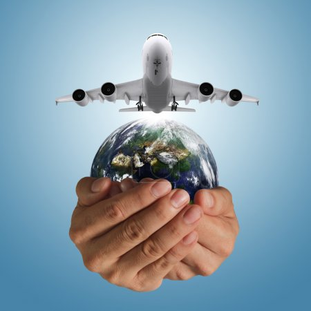 Hand holds airbus plane and globe as concept, elem...