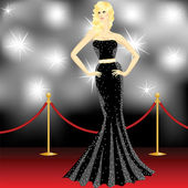 Famous beautiful elegant woman posing in front of the paparazzi on the red carpet