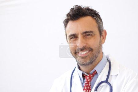 Smiling doc isolated on white