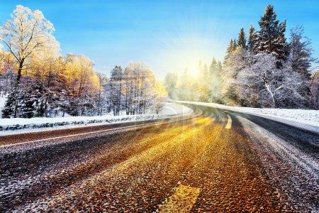 Winter road in sunlight