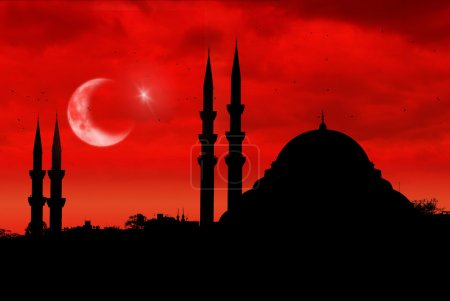 Mosque silhouette as the turkish flag during sunset