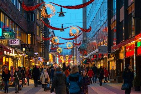 Christmas decorations along Drottninggatan during Christmas and rushhour.