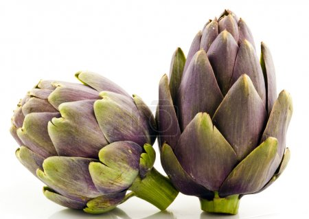 Two Artichoke Fruits on White