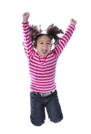 Photo pour Petite fille sautant de joie isolé sur fond blanc - image libre de droit
