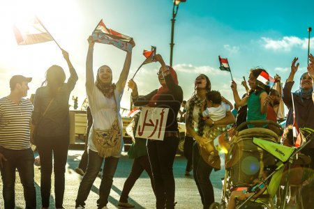 Egyptian Girls Protesting with Flags and LEAVE Sign