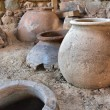 Clay pots used for storage of food and drinks into...