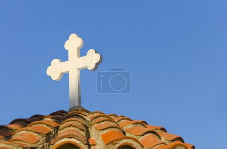 Cross on the top of old church.