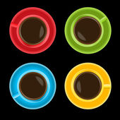 Colorful cups on black background
