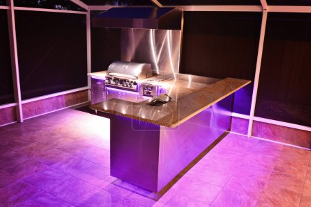 Outdoor kitchen with pink lighting