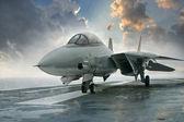 Stíhačka f-14 na palubě letadlové lodi pod dramatické cl