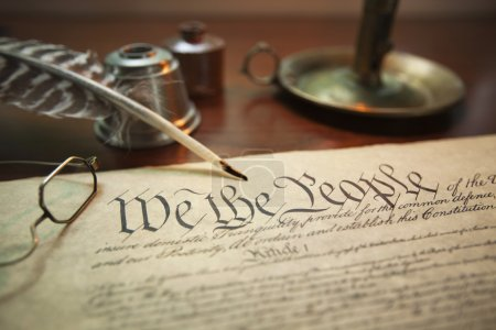 Photo for Selective focus image of the United States Constitution with quill pen, glasses and candle holder - Royalty Free Image