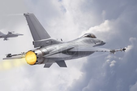 Photo for F-16 Fighting Falcon military jets (models) fly through clouds - Royalty Free Image