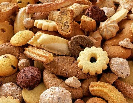 Photo for A culinary background of assorted crunchy fresh biscuits for teatime or dessert - Royalty Free Image