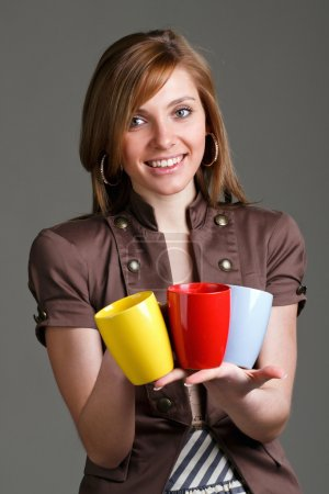 girl holding a colorful cups