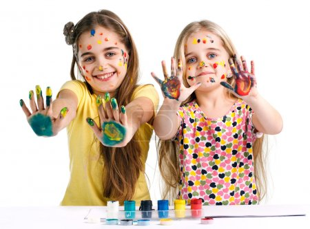 girls painted paints showing hands