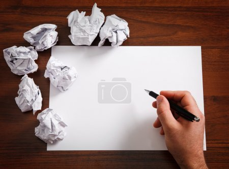 Photo for Blank paper waiting for idea with mans hand and pen - Royalty Free Image