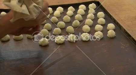German bakery squirt coconut macaroons onto plate wide