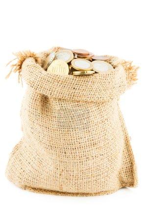 Photo pour Les chinks dans un sac de lin, bandé d'un ruban rouge cadeau, isolé sur un fond blanc - image libre de droit