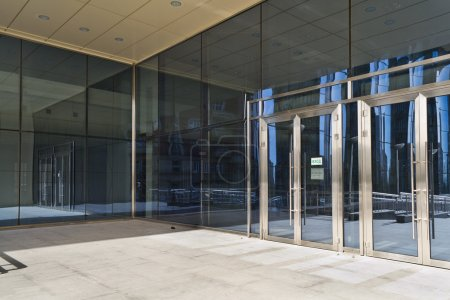Closed doors in modern large glass building