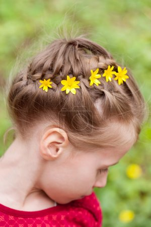 Hairstyle with braided hair and flowers