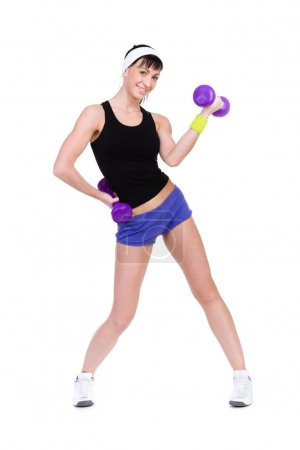 Healthy woman with dumbbells working out