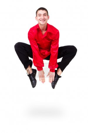 Man dancer jumping splits