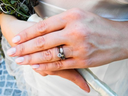 Bride wearing her diamond and wedding rings
