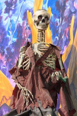 Skeleton at a amusement park ghost train