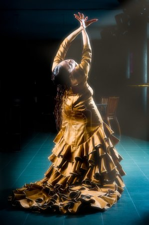 Photo for A female flamenco dancer in a golden dress - Royalty Free Image