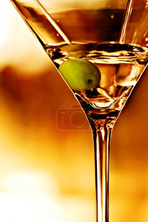 Photo for Glass of martini while poured in with olive - Royalty Free Image