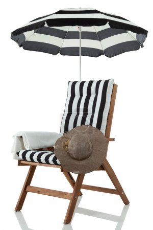 Beach chair with umbrella, towel and sunhat