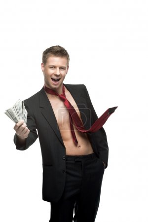 Sexy winking businessman in red tie holding money