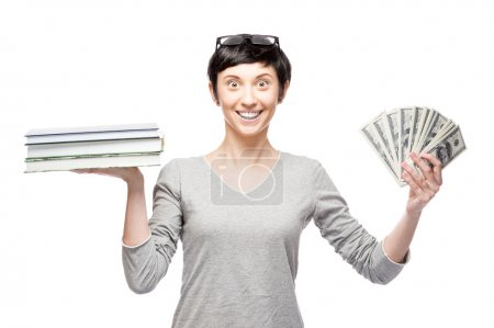 cheerful casual woman holding books and money