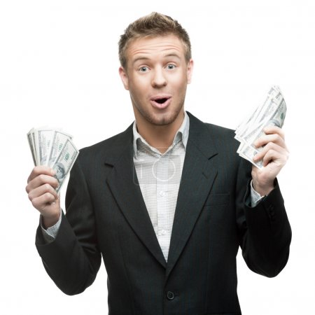 young surprised businessman holding money